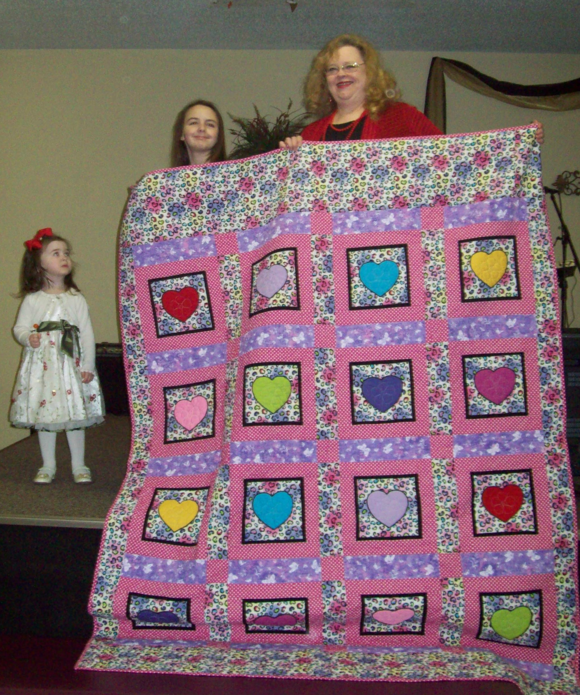 Name:  Deb and Breanna and Jaclyn with quilt.jpg
