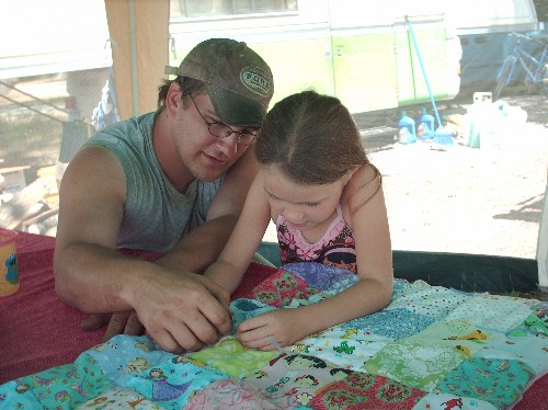 Name:  Maddy and dad learning to tie quilt.jpg