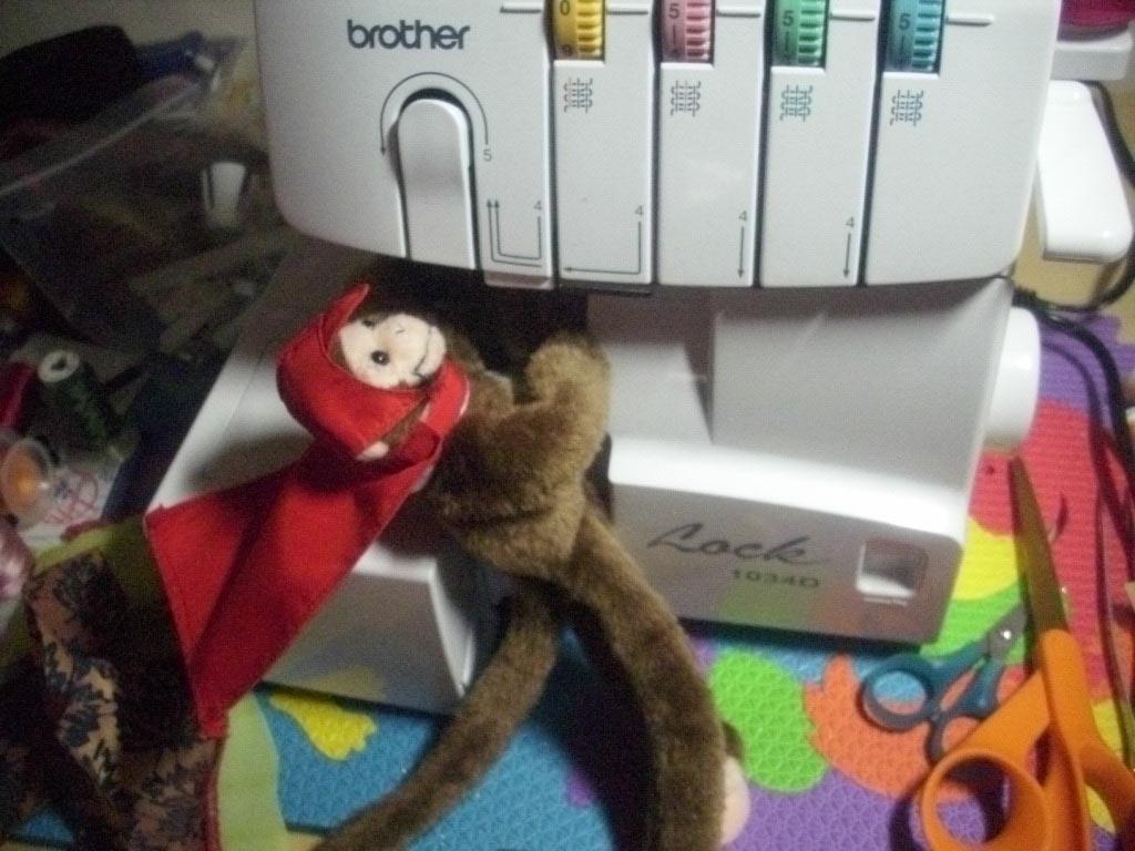 Name:  monkey fixing serger.jpg Views: 2786 Size:  131.0 KB