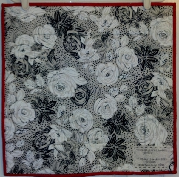 Name:  May 2012 Doll Quilt Back from Mariposa.jpg