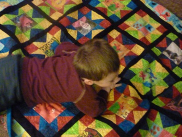 Name:  Kody receiving Elmo Quilt 007.jpg