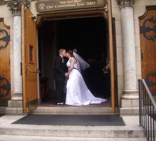 Name:  Blaze and Melissa in Church Door Small.jpg