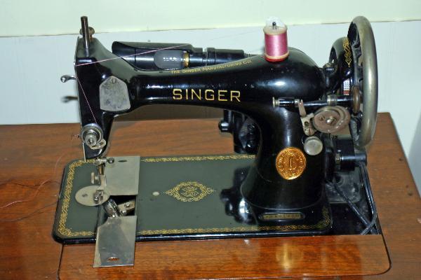singer sewing machine model 128 value