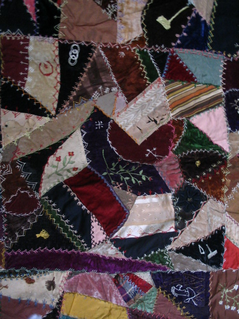 Name:  crazy quilt block with lots of flowers, hammer & wedge thingy.JPG