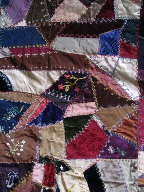 Name:  crazy quilt with 3 flower blocks.JPG
