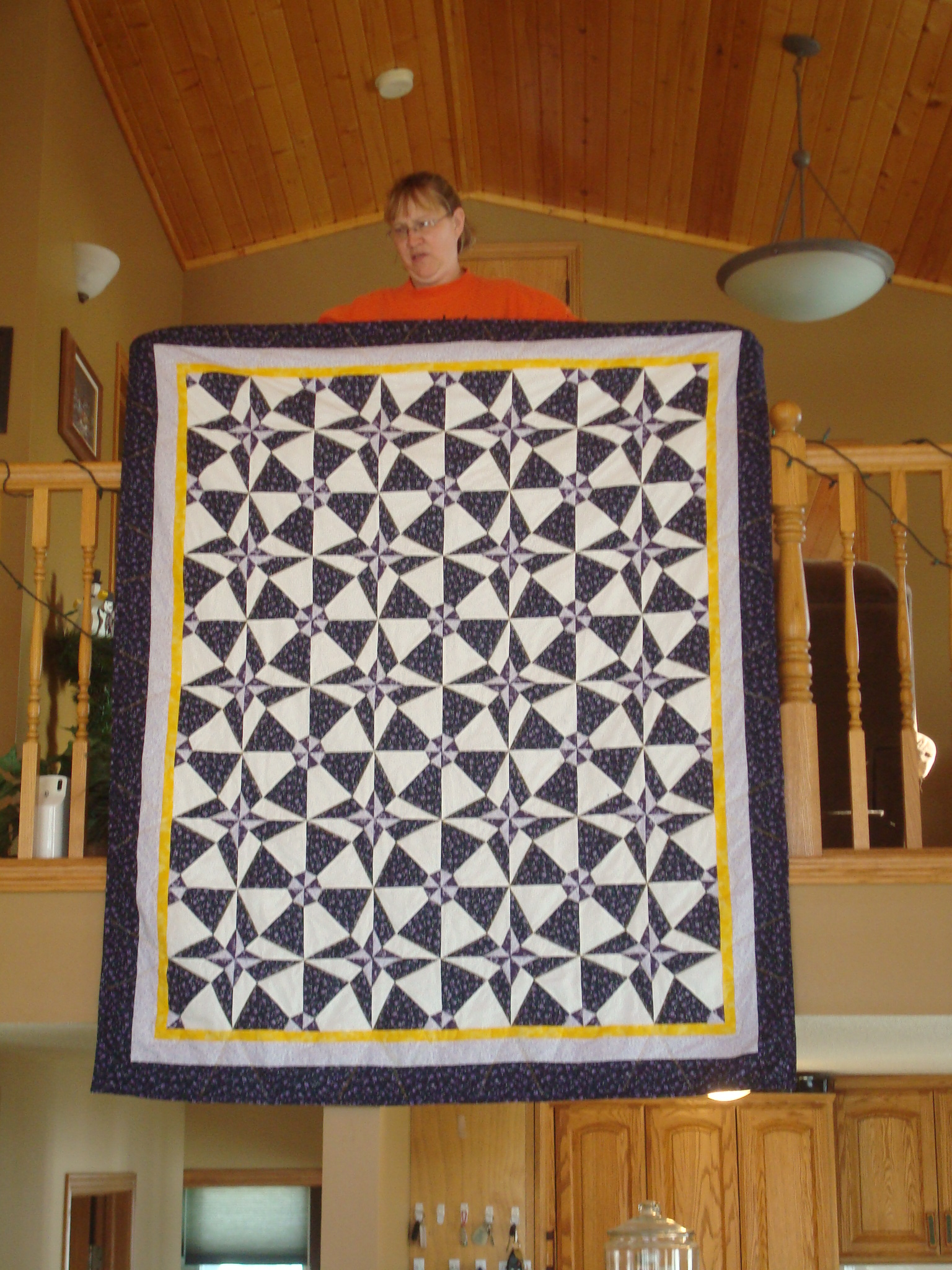 Name:  2011-12-31-Christmas at the lake-Janel with her Vikings quilt.jpg Views: 2117 Size:  982.4 KB