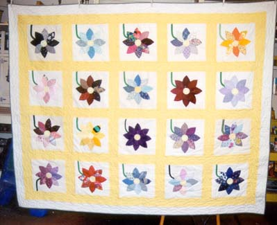 Name:  flowerquilt.jpg Views: 1663 Size:  29.0 KB