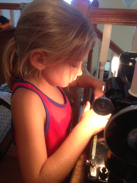 Name:  Emily sewing her first quilt 7-12.JPG