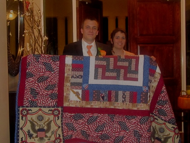 Name:  Couple with granny's quilt.jpg