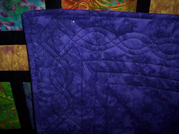 Name:  Batik Scrappy Road Close up quilting (576 x 432).jpg