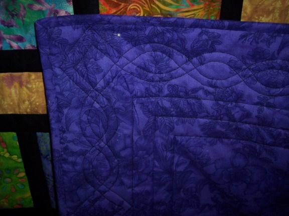 Name:  Batik Scrappy Road Close up quilting (576 x 432).jpg Views: 6581 Size:  63.1 KB