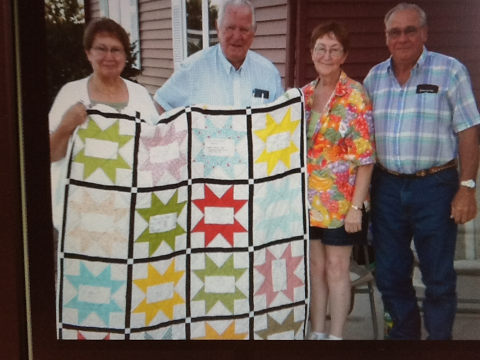 Name:  2012-July-Bev & Dick with my quilt.JPG
