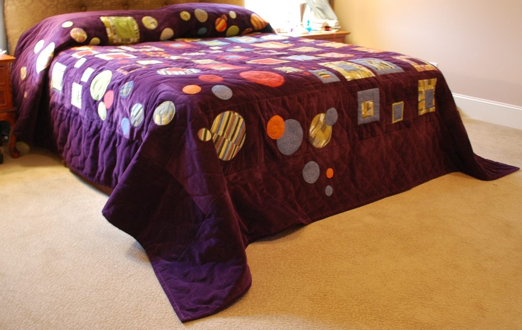 Name:  Lucia's quilt on a bed resized.JPG