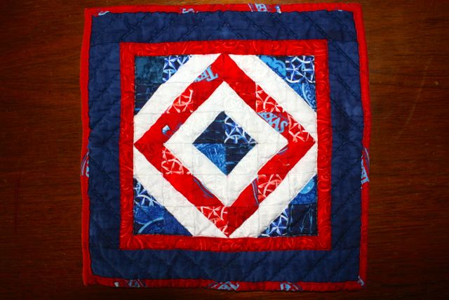 Name:  TX Diamond block quilted inta a hot pad. #1.jpg