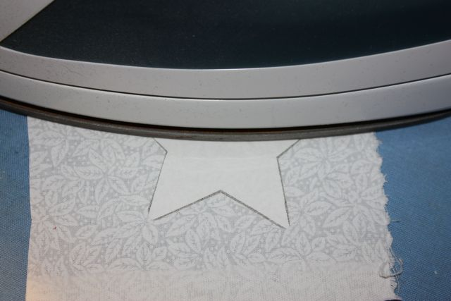 Name:  Applique  tute Press freezer paper star ta wrong side of fabric.jpg
